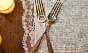 forks, candles, linen, wedding rings